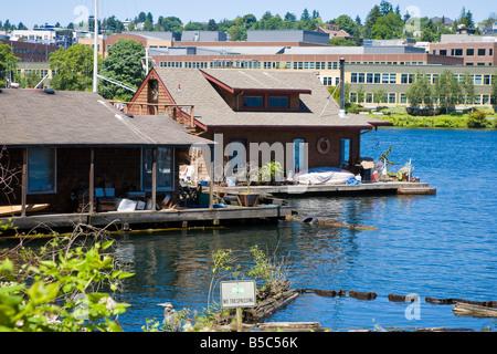 Floating homes on west shore of Lake Union in Seattle, Washington under the Aurora Avenue bridge - Stock Photo
