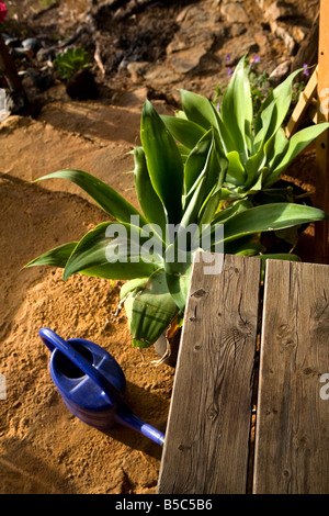 A veranda with table and watering can on the island of La Palma in the Canary Islands, Spain. - Stock Photo