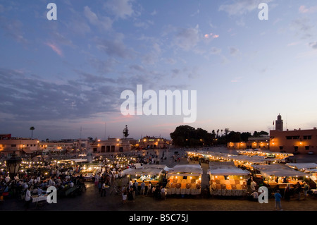 A wide aerial view of the Djemaa El Fna in Marrakesh and open air 'restaurants' as it starts to fill up in the evening/dusk. - Stock Photo