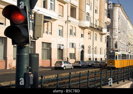 Yellow tram, red traffic light, Pest, Budapest, Hungary - Stock Photo