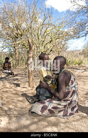 A woman of the the Hadza with her child Lake Eyasi Tanzania - Stock Photo
