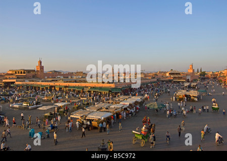 A wide aerial view of the Djemaa El Fna in Marrakesh as it starts to fill up in the late afternoon sun. - Stock Photo