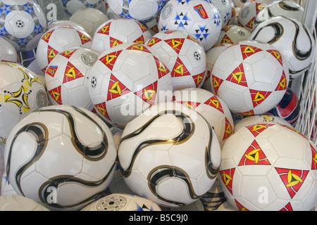 Footballs in arcade window