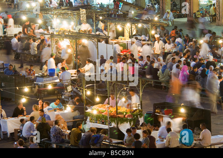 A compressed perspective aerial view of the open air 'restaurants' at the Djemaa El Fna with slow shutter speed - Stock Photo