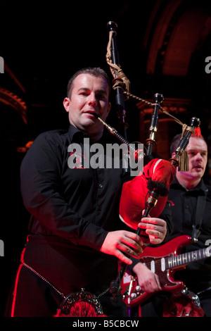 Red Hot Chilli Pipers Scottish electric bagpipe band cabaret in Edinburgh venue Mansfield Traquair centre - Stock Photo