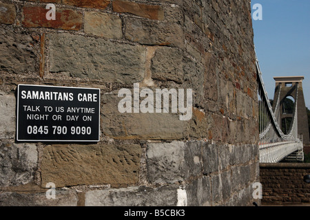 Samaritans sign on [Clifton Suspension Bridge] showing telephone number of suicide helpline, Bristol, England, UK - Stock Photo