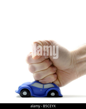 A MODEL CAR HIT AND SQUASHED BY A MANS FIST. - Stock Photo