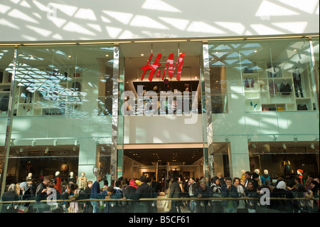 H&M outlet in Westfield Shopping Centre White City Development W12 London United Kingdom - Stock Photo