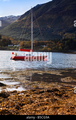 Red Yacht Moored On Loch Leven In The Scottish Highlands, Lochaber, Scotland. - Stock Photo