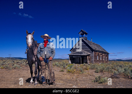 Cowboys and their horses - Stock Photo