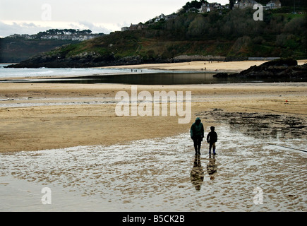 People walking on the beach at St Ives in Cornwall. - Stock Photo