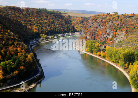 Ships passing famous Loreley rock, Rhine river, Germany - Stock Photo