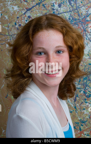 Portrait of a pretty young red haired blue eyed teenage girl of Irish descent - Stock Photo