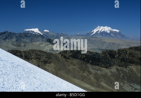 Mts Mururata (L) and Illimani (R) seen from Mt. Chacaltaya glacier in foreground, Cordillera Real, Bolivia - Stock Photo
