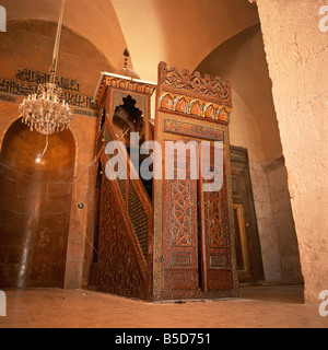 Carved wooden mimbar pulpit dating from C15th in interior of Grand Mosque founded in 715 in Aleppo Syria Middle - Stock Photo