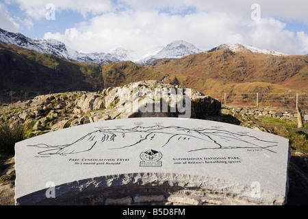 Information stone plaque showing mountains at Mount Snowdon horseshoe viewpoint with snow on mountain peaks. Snowdonia National Park North Wales UK.