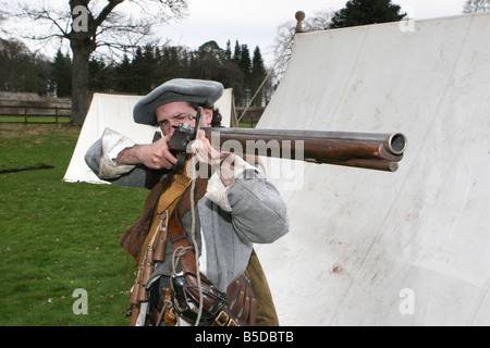 Costumed Performers _ Rifleman in historical period costumes of The Sealed Knot, Medieval Society, - Stock Photo