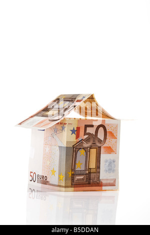 Single House made from Euro notes - Stock Photo