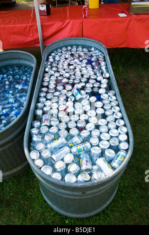 Aluminum Soda Cans in ice water trough - Stock Photo