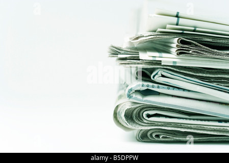 Stack of newspapers, close-up - Stock Photo