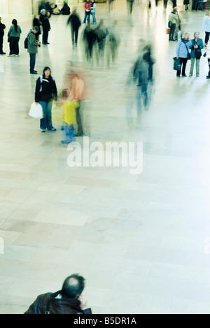 Tourists and commuters mingle in Grand Central Station in New York City - Stock Photo