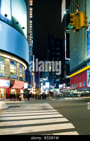 Crosswalk at intersection of W 43rd Street and Broadway at Times Square looking south down Broadway - Stock Photo