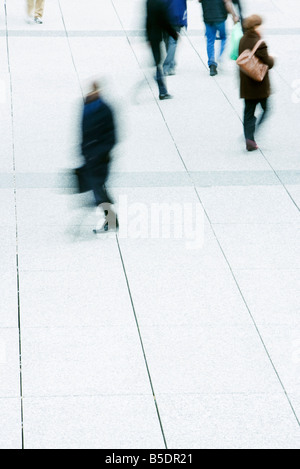 Pedestrians crossing public square - Stock Photo