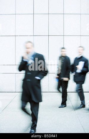 Pedestrians on sidewalk - Stock Photo