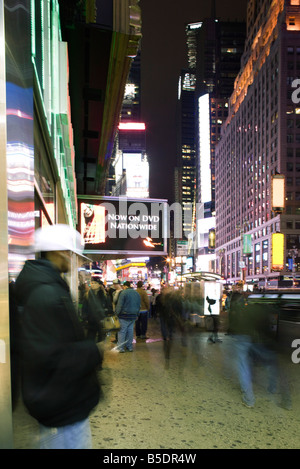 Sidewalk scene on Broadway in New York City looking north at Times Square - Stock Photo