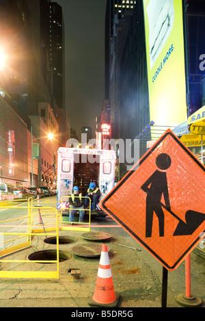 City workmen taking break from work on W 42nd Street near Times Square, New York City - Stock Photo