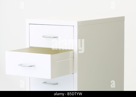 Chest of drawers, one drawer open - Stock Photo