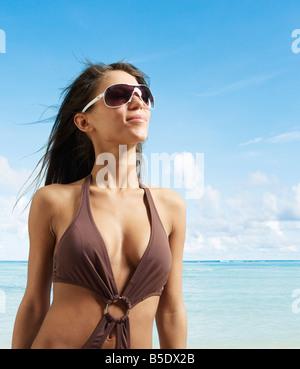 Young Woman in Beach Attire - Stock Photo