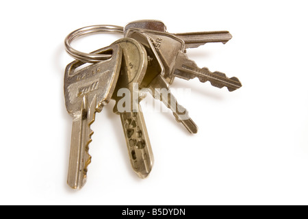 Bunch of house keys isolated on a white studio background - Stock Photo