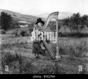 A Harpist wearing traditional Welsh National dress. 