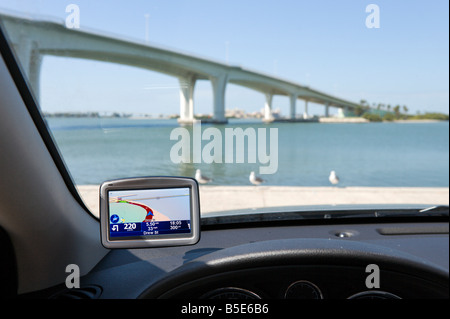 GPS Satellite Navigation System on the windscreen of a car in Clearwater, Florida, USA - Stock Photo