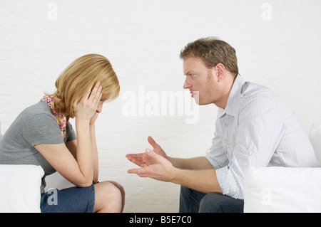Couple sitting vis-à-vis, arguing - Stock Photo