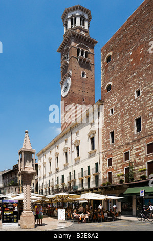 Street cafe and market in front of the Torre dei Lamberti in the Piazza delle Erbe, Verona, Veneto, Italy - Stock Photo