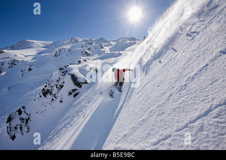 Austria, Tyrol, Zillertal, Gerlos, Freeride, Man skiing downhill - Stock Photo