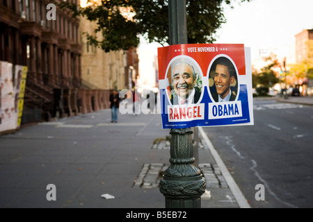 Obama Rangel yard sign fixed to a lamp post in Harlem New York USA - Stock Photo