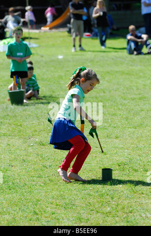 Child competing in flag race at Primary School Athletics carnival, Australia - Stock Photo