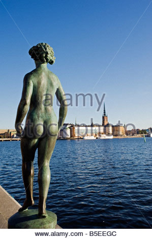 Statue in front of Stadshuset in front of the Stockholm Town Hall by Carl Eldh Stockholm with Riddarholmen to rear - Stock Photo
