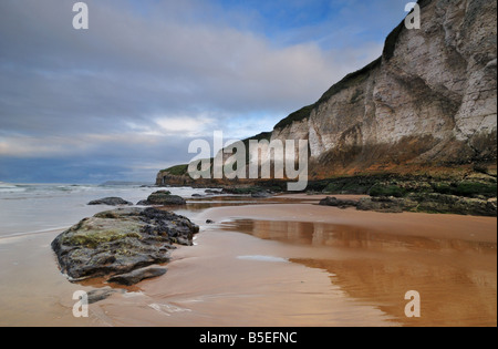 Whiterocks Beach in Portrush, Northern Ireland at sunset - Stock Photo
