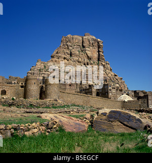 Walls and city below fortress on top of the mountain at Thulla, Yemen, Middle East - Stock Photo