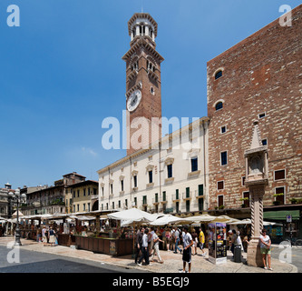 Market stalls in front of the Torre dei Lamberti in the Piazza delle Erbe, Verona, Veneto, Italy - Stock Photo