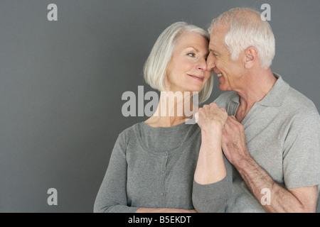 Amorous old couple - Stock Photo