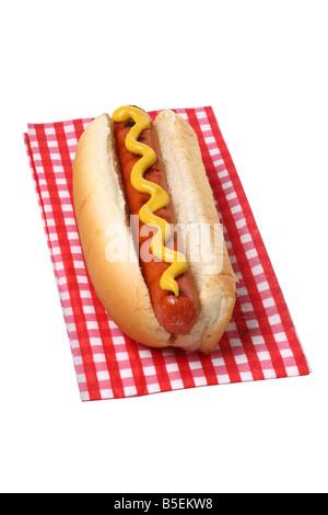 Hot dog on napkin cutout on white background - Stock Photo