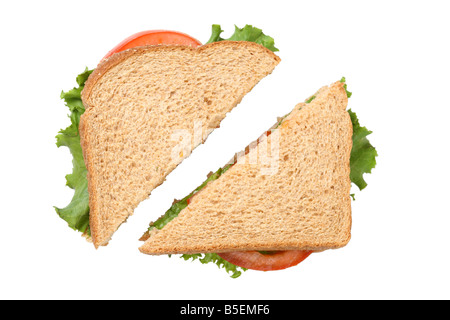 Sandwich cut in half cutout on white background - Stock Photo