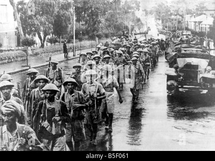 Soldiers from an Indian Infantry Brigade, Mar. through Asmara, capital of Eritrea on the Allies victorious advance. - Stock Photo