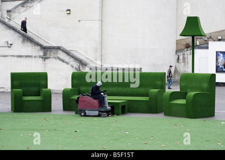Street cleaning outside the National Theatre London England - Stock Photo