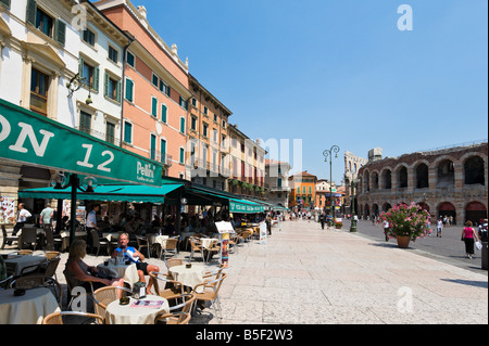 Street cafes in front of the Arena (amphitheatre) in Piazza Bra, Verona, Veneto, Italy - Stock Photo